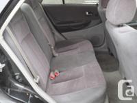 Make Mazda Model Protege Year 2003 Colour Black kms