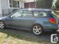 Make Subaru Colour Blue Trans Automatic kms 60300 What