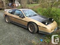 Make Pontiac Model Fiero Year 1986 Colour Gold Kms