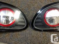 Aftermarket tail lights, fits 1995-2002 Chev Cavaliers.