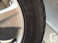 4 OEM Acura tsx wheels with Toyo Garit HT winter tire,