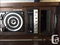 We have an old style cabinet stereo for sale. The radio
