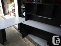 Office desk with two drawers and hutch. Black with