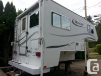 9' Okanagan camper basement model with electric jacks