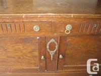 Old 100 year plus dresser with back panel. Oak, back