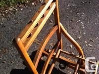 This is an old platform spring wooden rocking chair in