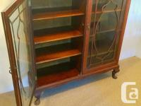 Solid wood China cabinet. Known to be old, but exact