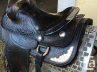 Older western trail saddle for sale. 15 Inch seat, 7
