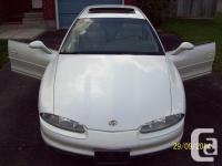 Make. Oldsmobile. Design. Aurora. Year. 1999. Colour.