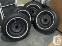 One set of four 14 inch Oldsmobile original full wheel