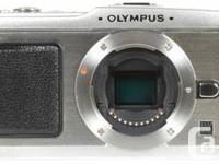 Olympus PEN E-P1 body  Mint problem, took it out only for sale  Quebec