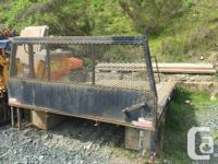 1 ton Flat Deck. Steel frame, wood deck. 12' long by