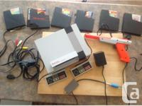 This is the original video gaming system. It includes, used for sale  Quebec