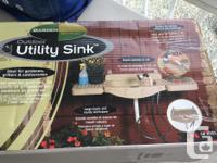 Brand new Outdoor Utility Sink in original box. Handy