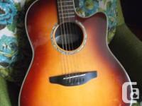It's a Balladeer, by Ovation, in super good shape. I
