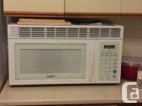 Moffat 1000 WATT over the range microwave.  It works