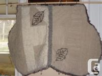 Wool saddle pad, locker-hooked over carpet canvas -