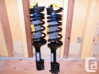 For sale is a *BRAND NEW* set of 2 rear MOOG strut