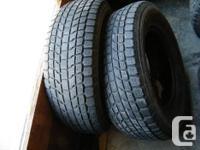 Pair of Yokohama Geolandar 235/ 70R16 tires with about