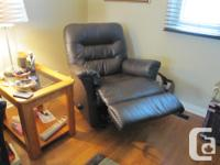 Palliser dark brown leather reclining couch and chair.