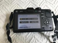 I am selling my wife's Panasonic Lumix DMC-GF1 12.1MP
