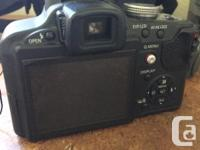 10.1 megapixels, 18x optical zoom, comes with case,