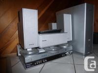 Panasonic VHS/DVD consul. 5 speakers plus Sub-woofer.