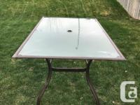 4 chairs, 2 swivel chairs, table, umbrella and stand for sale  Saskatchewan