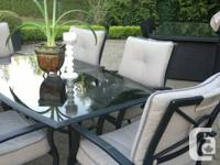 Beautiful patio furniture - glass top table and 6