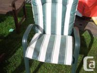 I AM SELLING A USED SET OF 4 CHAIRS WITH CUSHIONS AND A
