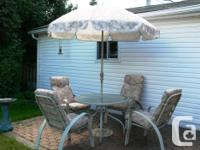 INCLUDES, GLASS TOP TABLE, 4 CHAIRS WITH THICK