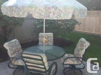 Patio Dining set consisting of 48 inch diameter glass