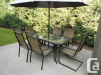 Table and 8 foot tilting umbrella. Comes with 6 chairs