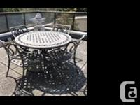 Good condition, table is 4 feet diameter, four chairs