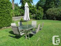 Glass topped table and 6 chairs, with umbrella and