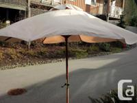 8 ft. round canvas umbrella. Stands approx. 8 ft. for sale  British Columbia