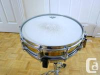 "For sale a 14"" x 3.5"" Pearl brass shell free-floating"
