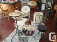 An experienced 8 piece drum set for sale, two extra