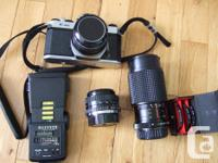 Pentax K1000 body, flash, three lenses (std, tele,