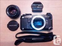 The black Pentax LX is in very good cosmetic and