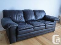 This black leather couch is in mint condition and made
