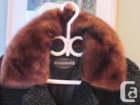 Black Persian lamb coat with a mink collar. In good