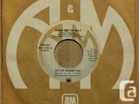 "FRAMPTON Peter Frampton?s 1976 45-RPM ""Show me the"