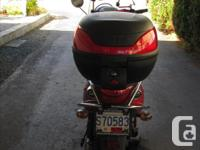 Red, 2007, 50 cc, gas scooter, running condition. Can