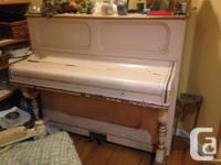 Upright piano, circa 1870. Repaired crack in sound