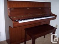 Upright Samick piano for sale.  Call
