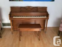 Piano for sale. This piano also comes with a bench.