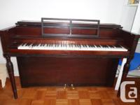 Apartment size piano This lovely piece of furniture