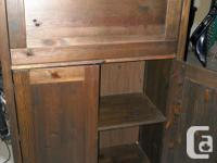 "walnut stained pine cabinet 59""hx38""hx17""deep. Has two"
