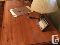 A beautiful pine desk, including a file box .